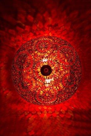 Orientalische Deckenlampe Orange Bohemian brennend